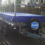 Lm85 trailer cover with opening front for ladder rack in blue
